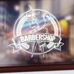 Sticker du logo d'un barbier sur une vitrine