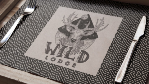 Logo-art sur un set de table pour le Wild Lodge.